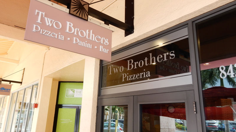 Skyzign installation of Two Brothers Pizzeria Frosted Signs